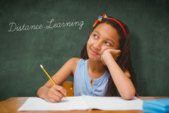 Distance learning against green chalkboard Stock Images
