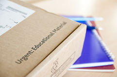 Distance learning delivery. High angle shot of distance learning cardboard box with notebooks underneath Stock Photos