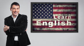 Distance Learning english concept. Cheerful young businessman Stock Photo