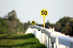 Distance Marker. On a fence at a horse racecourse Stock Image