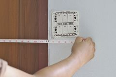 Distance measurement Wall switch panel. Hire to install home electrical systems stock photography