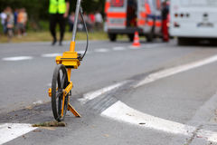 Distance measuring wheels. Meter measuring wheels, used to measure distance. Used by police for accident footage Royalty Free Stock Photo