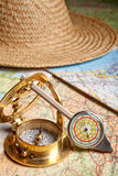Distance meter and compass. Vintage distance meter, compass and maps of a tourist Royalty Free Stock Photo