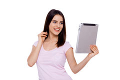 Distance is not a problem. Pretty cheerful young woman holding her touchpad with smile Royalty Free Stock Photos