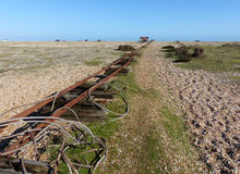 Into the distance. Relics of the former railway line at Dungeness, Kent Royalty Free Stock Photography