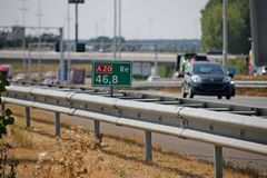 Distance sign in green on the shoulder of the motorway A20 at Moordrecht in the Netherlands.  stock images