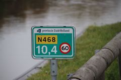 Distance sign on provincial road N468 at Schipluiden in the Netherlands with speed limit 60 kilometers. Distance sign on provincial road N468 at Schipluiden in stock photo