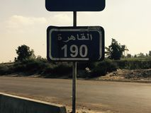 Distance sign. Says that 190 km left to arrive stock photography