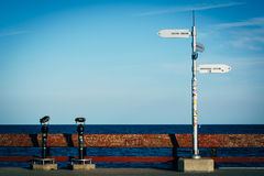 Distance signs on the fishing pier at Centre Island, in Toronto, Stock Photo
