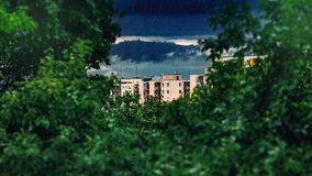 In the distance a thunderstorm is formed. Rain falls, green foreground in the foreground Royalty Free Stock Photo