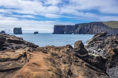 Cape Dyrholaey in Iceland. Distance view of Dyrholaey foreland located on the south coast of Iceland royalty free stock images