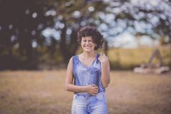 In Distance Woman Wearing Blue Scoop-neck Sleeveless Top and Blue Denim Bottoms royalty free stock images