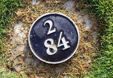 Distance yardage marker on golf course Royalty Free Stock Image