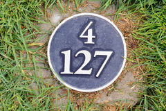Distance yardage marker on golf course Stock Photo