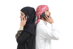 Distant arab couple calling on the phone Stock Photo