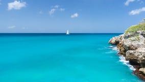 Distant boat on ocean horizon meeting blue sky Royalty Free Stock Photo