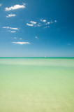 Distant boat on turquoise water Stock Photos