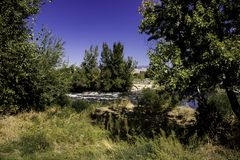 Distant Boise River. The Boise river flows with rapids in the distance stock photography