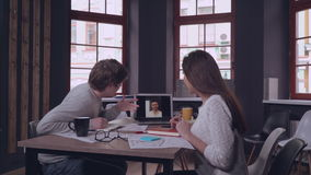 Distant call in office startup company. stock video