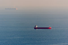 Distant Cargo Ships Stock Image