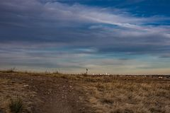 Distant City of Denver across grassy prairie stock photo