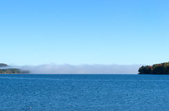 Distant cloud bank on lake Royalty Free Stock Photos