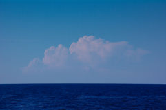 Distant Cumulus Clouds Stock Images