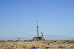 Distant drill rig Stock Photos