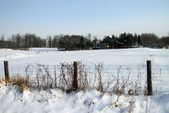 Distant farmhouse in the winter Royalty Free Stock Image