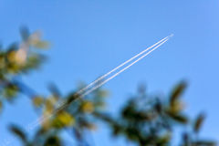 Distant flying jet airplane making contrail Royalty Free Stock Photo