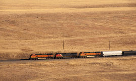 Distant Freight Train. In dying light on the Colorado prairie Royalty Free Stock Image