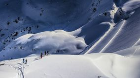 Group of skiers waiting. Distant group of skiers in winter scenerey Royalty Free Stock Images