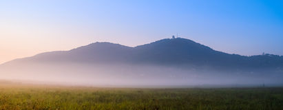 Distant hills on misty morning. Distant hills of Vrsac in Serbia on misty morning light - Panorama image Stock Photos