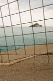 Distant island behind an iron fence Royalty Free Stock Photos