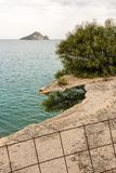 Distant island behind an iron fence Royalty Free Stock Images