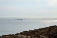 A Distant Island - Dead Calm Sea Stock Image