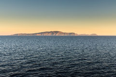 Distant Italian island coast at sundown Royalty Free Stock Images