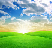 Distant Landscape Sunset. Beautiful Distant Green Landscape Sunset Royalty Free Stock Image