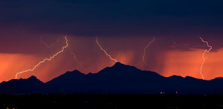 Distant Lightning at Sunset stock photo