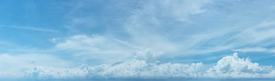 Distant Line of Storm Clouds in a Sunny Sky Stock Images