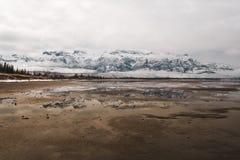 A distant mountain range against a flooded plain stock photo