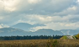 Distant mountains in clouds. landscape stock image