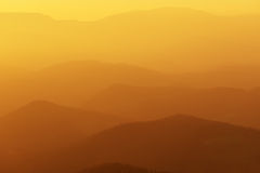 Distant mountains at the sunset Stock Photo