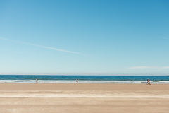 Distant people walking on beach. On sunny summer day at Inch Beach,Kerry,Ireland Royalty Free Stock Photo