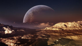 Distant Planet. Huge moon in the horizon of a deserted lonely and distant planet. Very much a science fiction environment Stock Photo
