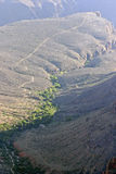 Distant, Plant Covered Grand Canyon River Royalty Free Stock Images