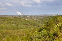 Distant Power Station in Forest Landscape Stock Images