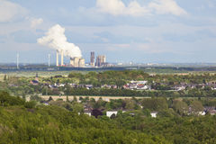 Distant Power Station in Rural Landscape Stock Photography