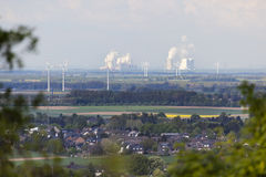 Distant Power Stations framed by trees Stock Image