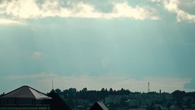 Distant rain in residential area. Time lapse stock video footage